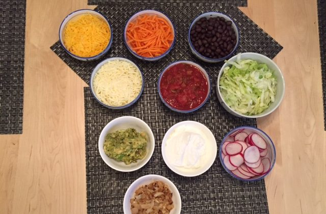 It is easy to switch out some of the classic ingredients of taco toppings with fresh and less processed foods (photo by LivligaHome).