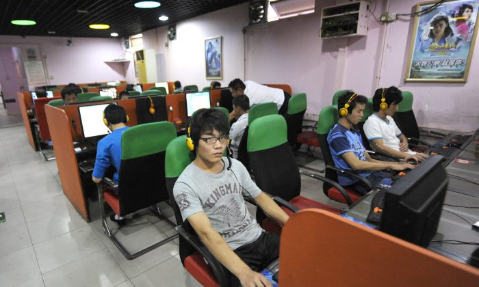 A young man uses a computer at an Internet bar in Beijing on September 8, 2011.  (Liu Jin/AFP/Getty Images)