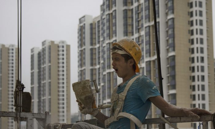 A Chinese construction worker at a new apartment complex on August 29, 2014 in Beijing, China.  (Kevin Frayer/Getty Images)