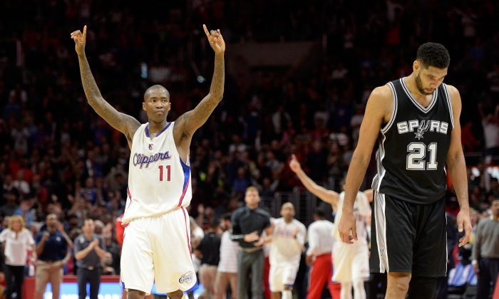 Jamal Crawford (L) and the Los Angeles Clippers topped Tim Duncan (R) and the San Antonio Spurs back on February 19 and then again in the first round of the NBA Playoffs. (Harry How/Getty Images)
