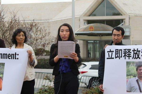Teresa You (C) speaks at a rally outside the Chinese Embassy