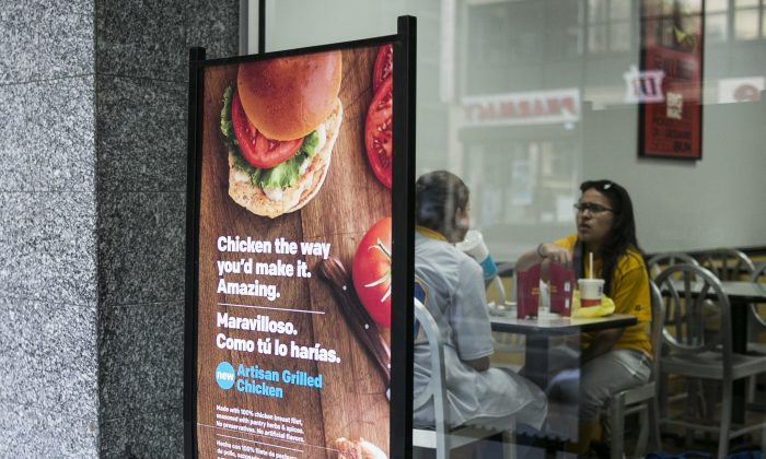 An ad displaying one of McDonald's newest products, the Artisan Grilled Chicken, at one of their restaurants in Manhattan, New York, on May 4, 2015. (Samira Bouaou/Epoch Times)