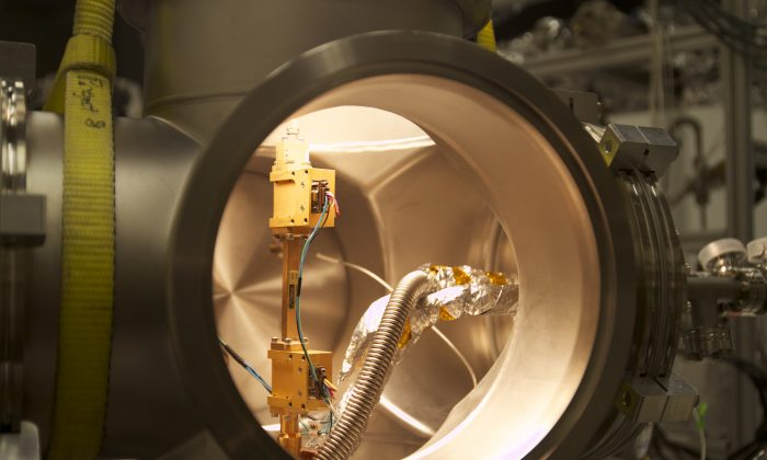 The team built a small apparatus to contain a single high-energy electron in a magnetic field containing krypton-83, a radioactive isotope that produces electrons as its nuclei undergo beta decay. (Credit: Jared Kofron, University of Washington)