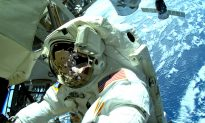 Astronauts Help Move Stalled Rail Car During Spacewalk