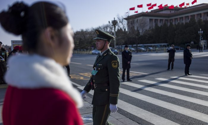 A paramilitary police officer crosses a road during the opening session of the Chinese People's Political Consultative Conference (CPPCC) at the Great Hall of the People in Beijing on March 3, 2015. (Fred Dufour/AFP/Getty Images)
