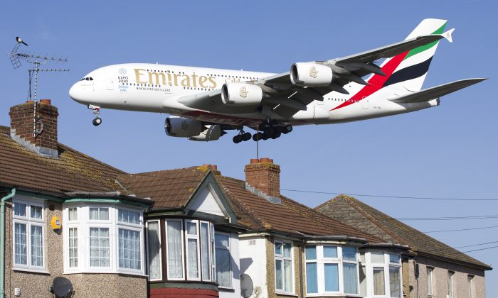 An Emirates Airbus A380 aircraft is seen above roof top as it comes into lane at Heathrow Airport in west London on February 18, 2015. (Justin Tallis/AFP/Getty Images)