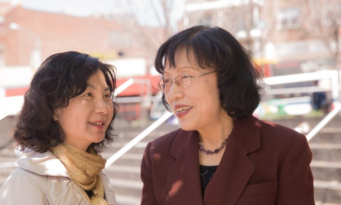 Mi Ruijin (L) and Zhang Yijie (R) together in Flushing, New York, on May 2, 2015. (Laura Cooksey)