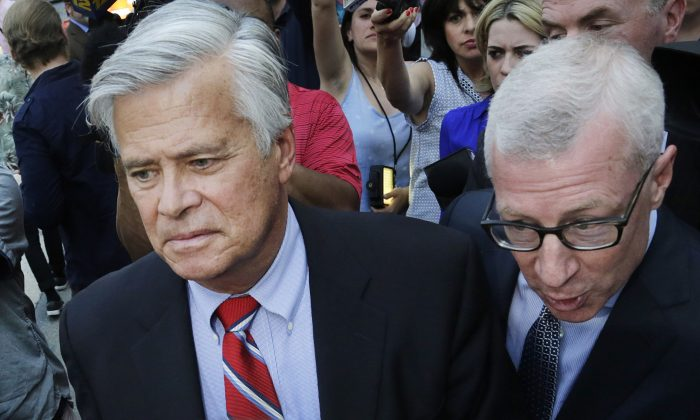 New York Senate Majority Leader Dean Skelos, center, leaves federal court, Monday, May 4, 2015, in New York. (AP Photo/Mark Lennihan)
