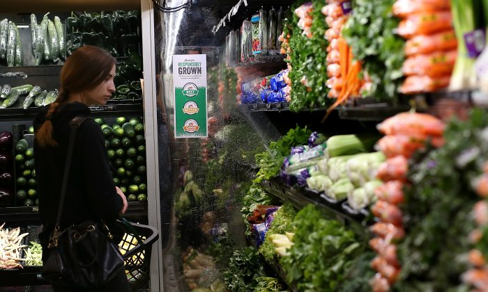 "SAN FRANCISCO, CA - OCTOBER 15:  A customer shops for produce at a Whole Foods market on October 15, 2014 in San Francisco, California. Upscale grocery chain Whole Foods Market launched a ratings program for fruits, vegetables and flowers that is intended to inform consumers about how the produce was grown, the environmental imapct and treatment of the workers wh produced it. The program is called ""Responsibly Grown"" and will label fruits and vegetables as good, better, or best, depending on growing conditions. (Photo by Justin Sullivan/Getty Images)"