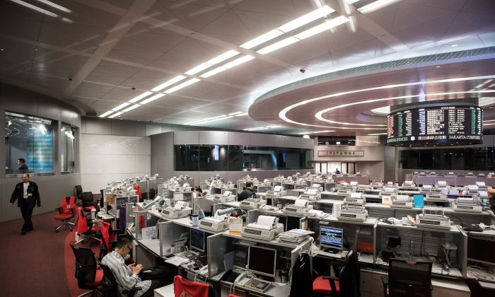 A trader sits at the stock exchange in Hong Kong's financial district on Nov. 10, 2014. (Philippe Lopez/AFP/Getty Images)