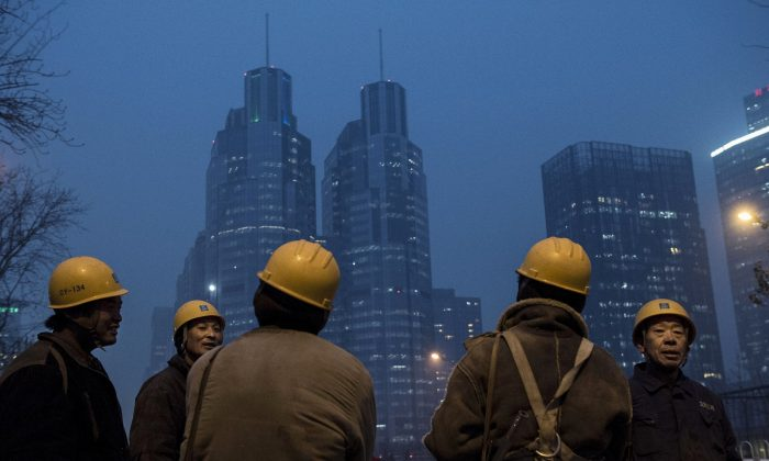 Chinese migrant workers at a construction site in Beijing, on Dec. 9, 2014. The constant inflow of workers from the countryside might have already turned around, according to several estimates. (Kevin Frayer/Getty Images)
