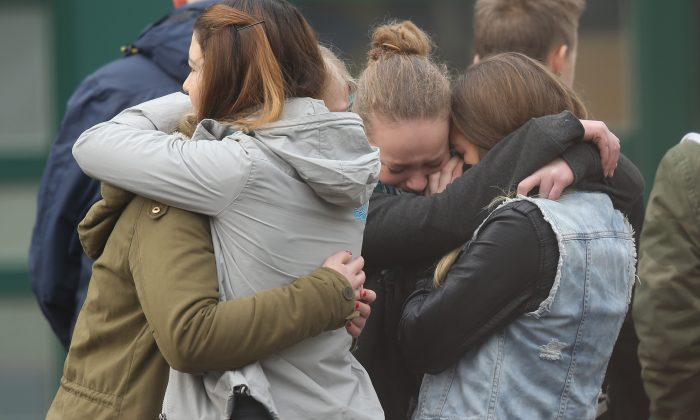 Pupils gather at the Joseph-Koenig-Gymnasium high school in France to pay tribute to 16 students and two teachers from the school who were on Germanwings flight that crashed in Haltern, Germany, on March 25. Sean Gallup/Getty Images)