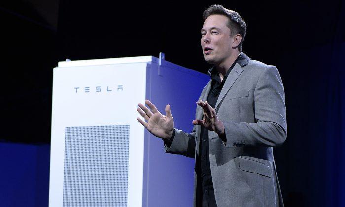 Elon Musk, CEO of Tesla, unveils suite of batteries for homes, businesses, and utilities at Tesla Design Studio on April 30 in Hawthorne, Calif. (Kevork Djansezian/Getty Images)