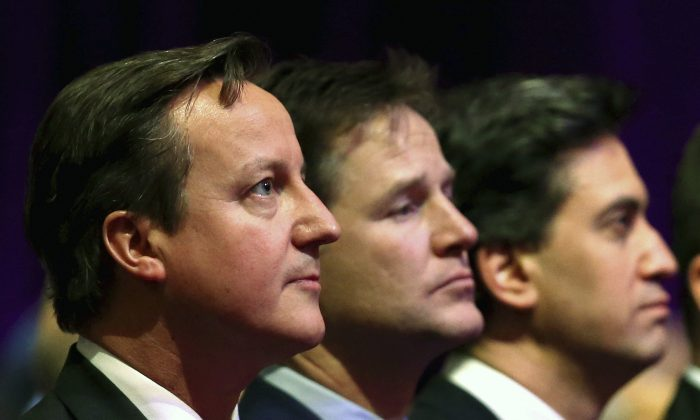 British Prime Minister David Cameron, Deputy Prime Minister Nick Clegg and opposition Labour Party leader Ed Miliband attend a Holocaust Memorial Day ceremony at Central Hall Westminster in London on Jan. 27, 2015. (AP Photo/Chris Jackson)