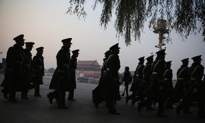 Paramilitary policemen patrol at Tiananmen Square on November 8, 2013 in Beijing, China. (Feng Li/Getty Images)