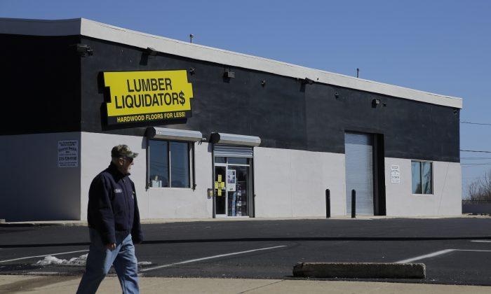 A man walks past a Lumber Liquidators store, Thursday, March 12, 2015, in Philadelphia. (AP Photo/Matt Slocum)