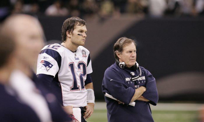 Tom Brady (L) and New England Patriots head coach Bill Belichick in a file photo. (Patrick Semansky/AP Photo)