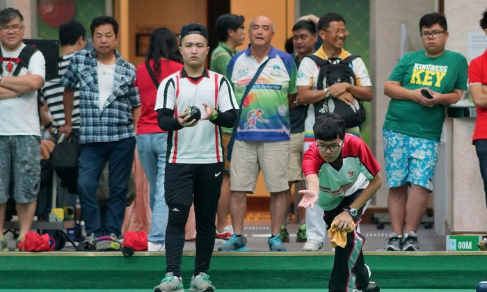 Yan Oi Tong Tin Ka Ping Secondary School skipper Lyndon Sham maintains his concentration in the final of the Hong Kong Inter-schools Lawn Bowls Competition on Friday May 1 against Yan Chai Hospital No.2 Secondary School to win their second title in three years. (Mike Worth)