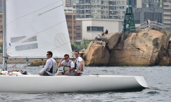 (L-R) Nick Faulks, Anthony Day and Peter Backe in Etchells 1333 Jezebel returning through Lei Yue Mun gap after winning the HKRNVR pursuit race on Friday May 1. (Bill Cox/Epoch Times)