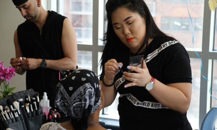A MAC Cosmetics stylist applies make-up to a formerly incarcerated woman as part of an empowering make-over on May 7, 2015 in Harlem, New York. (Courtesy of The Fortune Society)