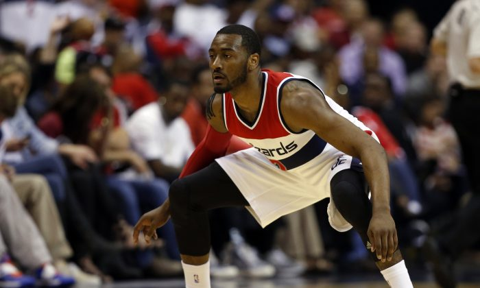 Washington Wizards guards John Wall (2) stands ready in the second half of Game 4 in the first round of the NBA basketball playoffs against the Toronto Raptors, Sunday, April 26, 2015. (AP Photo/Alex Brandon)