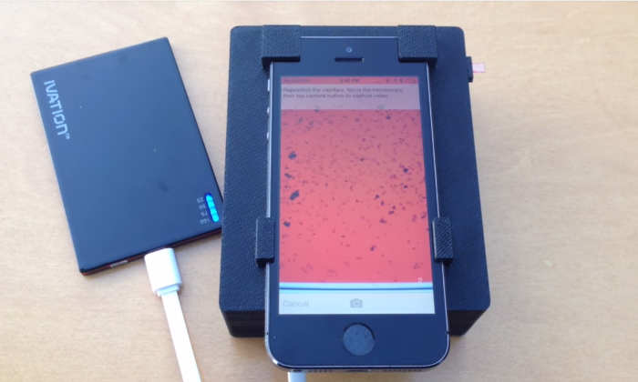 A smartphone analyzes a blood sample for parasites (Mike D'Ambrosio and Matt Bakalar, Fletcher Lab, UC Berkeley)
