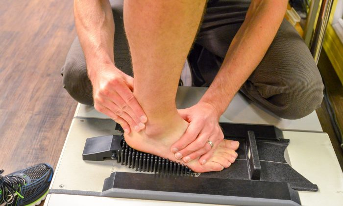 A Foot Solutions customer receives a complimentary foot and gait analysis by a foot specialist to determine a good fit. (Foot Solutions)