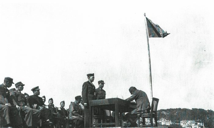 U.S. Marine Corps personnel represent Nationalist Chinese forces as Japanese officers sign surrender documents at the end of World War II in August 1945. (U.S. Marine Corps)