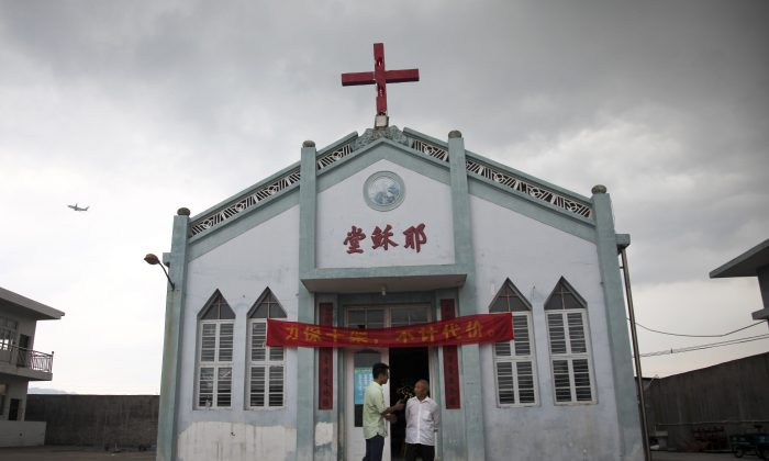 "Wuxi Christian Church with the words ""Church of Jesus"" in red, in Longwan, Wenzhou in eastern China's Zhejiang province. (AP Photo/Didi Tang)"