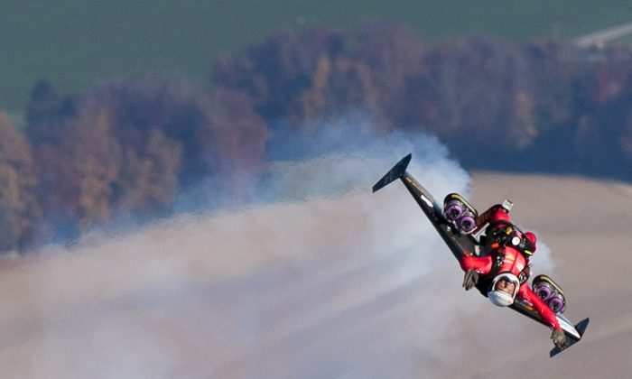 Swiss pilot Yves Rossy, the first man in the world to fly under a jet-fitted wing, speeds through the air performing a looping after launching from a hot air balloon on November 5, 2010 above Bercher, western Switzerland. (LAURENT GILLIERON/AFP/Getty Images)