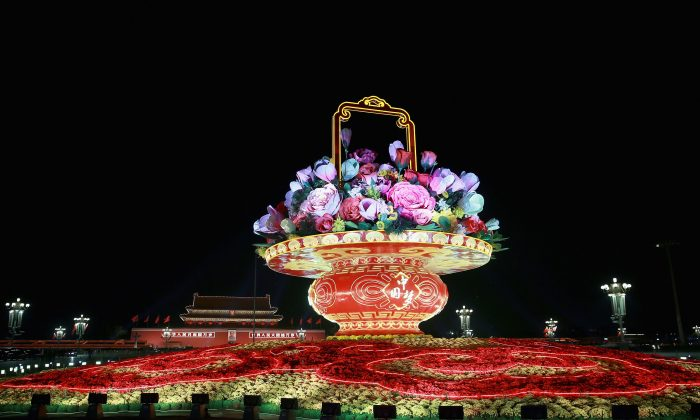 A giant flower arrangement for celebrating the 65th anniversary of the founding of the People's Republic of China is seen at Tiananmen Square on September 30, 2014 in Beijing, China (Feng Li/Getty Images)