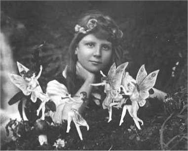 The first of the five photographs, taken by Elsie Wright in 1917, shows Frances Griffiths with the alleged fairies. (Wikimedia Commons)