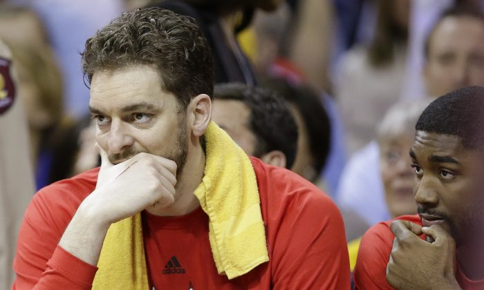 Chicago Bulls forward Pau Gasol (L) missed Sunday's Game 4 against Cleveland and may be out longer with a hamstring injury. (AP Photo/Tony Dejak)