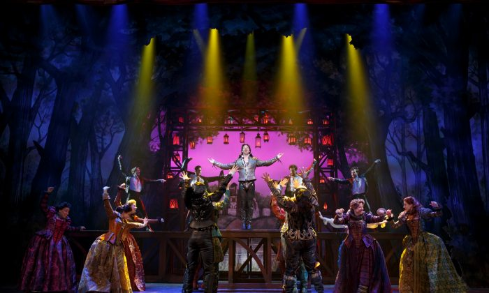 "The Bard (Christian Borle)  revered as something akin to a rock star, is surrounded by his adoring fans (the cast), in ""Something Rotten!."" (Joan Marcus)"