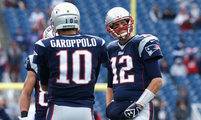 Jimmy Garoppolo (L) will likely see some playing time during Tom Brady's four-game suspension. (Photo by Jim Rogash/Getty Images)