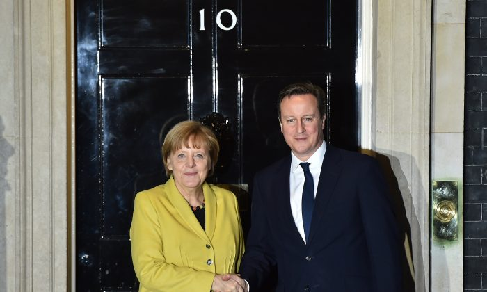 British Prime Minister David Cameron (R) poses with German Chancellor Angela Merkel outside 10 Downing Street in central London on Jan. 7, 2015. (Leon Neal/AFP/Getty Images)