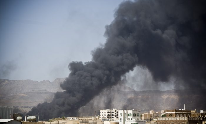 Smoke rises after a Saudi-led airstrike hit a site believed to be a munitions storage, in Yemen's capital, Sanaa, on Tuesday, May 12, 2015. (AP Photo/Hani Mohammed)