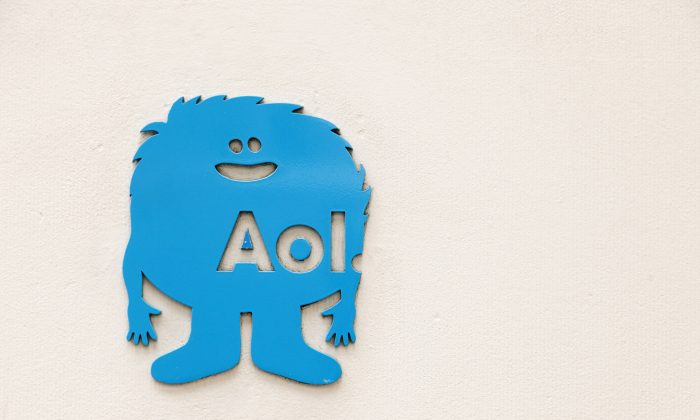 An AOL logo is posted outside the building where the company's headquarters is located, Tuesday, May 12, 2015 in New York. Verizon is buying AOL for about $4.4 billion, advancing the telecom's push in both mobile and advertising fields. (AP Photo/Mark Lennihan)