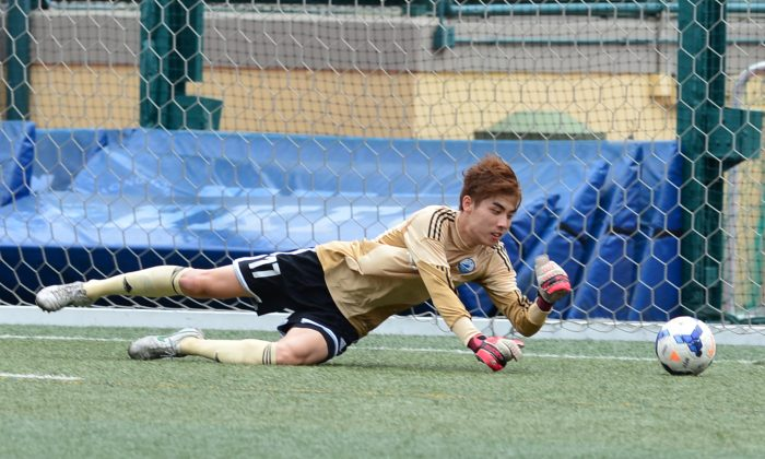 Sun Hei goalkeeper made some important saves, including this shot during their 3-2 defeat to Lucky Mile, at Sports Road on Sunday May 10, 2015. (Bill Cox/Epoch Times)