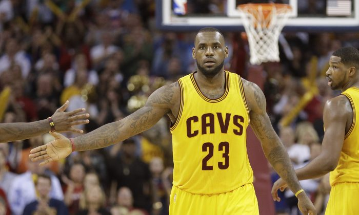 Cleveland Cavaliers forward LeBron James slaps scored 38 points in a Game 5 win over Chicago to put his team up three games to two. (AP Photo/Tony Dejak)