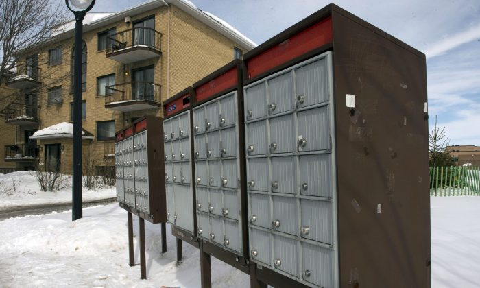 A community mailbox is seen in the east end of Montreal March 5, 2015. A survey of residents in communities that have lost home postal delivery shows respondents having problems accessing the new mailboxes due to snow, as well as incidents of slips and falls. (The Canadian Press/Ryan Remiorz)