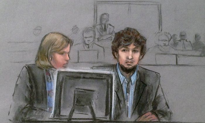In this courtroom sketch, Dzhokhar Tsarnaev, right, and defense attorney Judy Clarke are depicted watching evidence displayed on a monitor during his federal death penalty trial Monday, March 9, 2015, in Boston. (Jane Flavell Collins via AP)