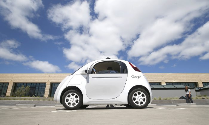 Google's new self-driving prototype car is presented during a demonstration at the Google campus in Mountain View, Calif. The car, which needs no gas pedal or steering wheel, will make its debut on public roads this summer. (AP/Tony Avelar)