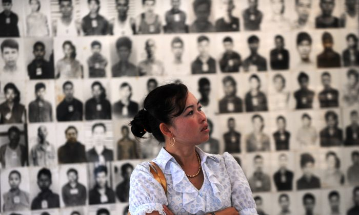 A Cambodian woman looks at portraits of victims of the Khmer Rouge at the Tuol Sleng genocide museum in Phnom Penh on Nov. 17, 2011. A U.N. tribunal for trying those most responsible for the genocide has run into interference from the Cambodian government. (TANG CHHIN SOTHY/AFP/Getty Images)
