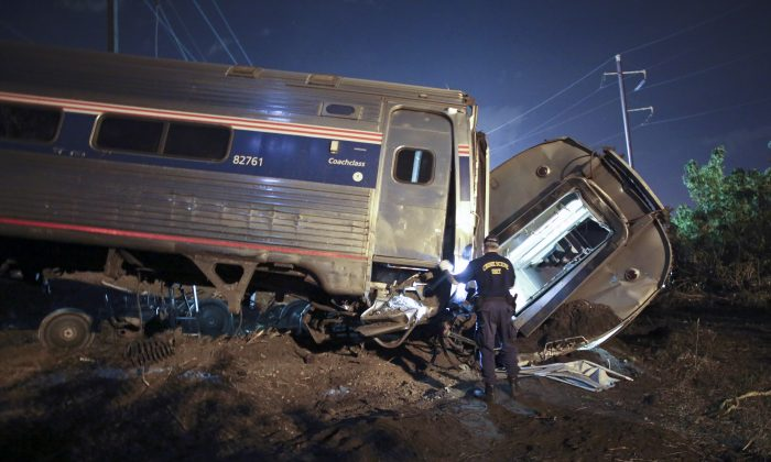 Emergency personnel look for passengers on the Amtrack train wreck in Philadelphia on May 12. (AP Photo/ Joseph Kaczmarek)