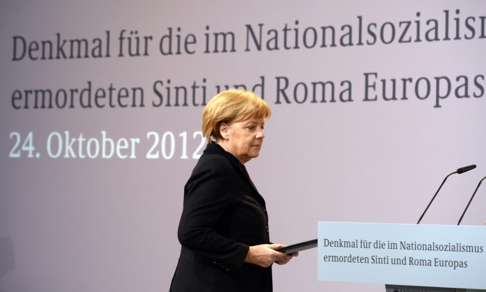 German Chancellor Angela Merkel arrives to deliver her speech during the unveiling ceremony of the memorial to the Roma and Sinti victims of the Nazi Holocaust during World War II, in Berlin Oct. 24, 2012. Recognition of Roma persecution has been rare. (RAINER JENSEN/AFP/Getty Images)