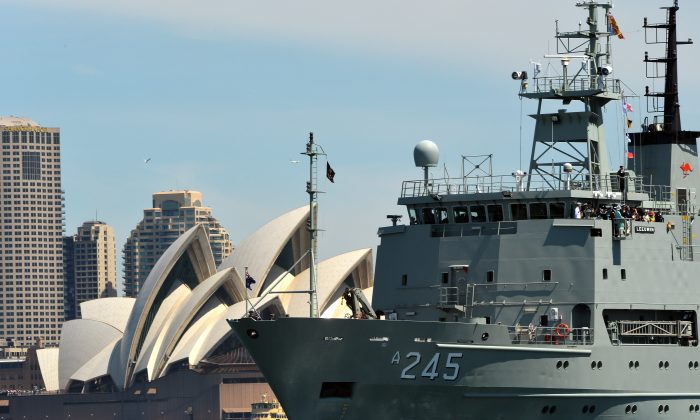 Australia's warship HMAS Leeuwin sails during the 2013 International Fleet Review in Sydney on October 5, 2013. Australia is considering sending navy ships to help challenge the Chinese regime's claims in the South China Sea. (Saeed Khan/AFP/Getty Images)