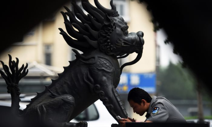 A security guard outside a bank in Beijing on July 3, 2014. China and the Western-led IMF are very close on reaching an agreement on increasing Chinese influence on the global financial system. (GREG BAKER/AFP/Getty Images)