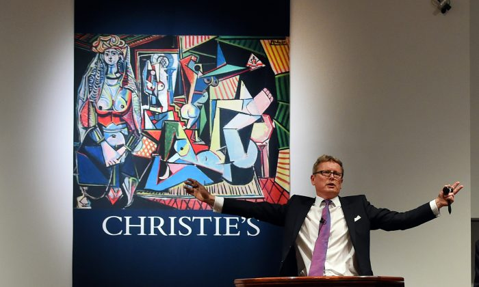 Auctioneer Jussi Pylkkanen takes bids on the Picasso painting 'Les Femmes d'Alger (Version O)' at Christie's in New York City on May 11, 2015, which went for USD 179.3 million, smashing the record for most expensive art sold at auction. (Timothy A. Clary/AFP/Getty Images)