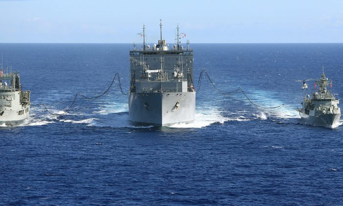 Australian naval ships replenish a United States Navy ship in the South Indian Ocean during the search for missing Malaysia Airlines Flight MH370 on April 12, 2014. Australia is considering sending navy ships to help challenge the Chinese regime's claims in the South China Sea. (LSIS James Whittle/Australia Department of Defense via Getty Images)
